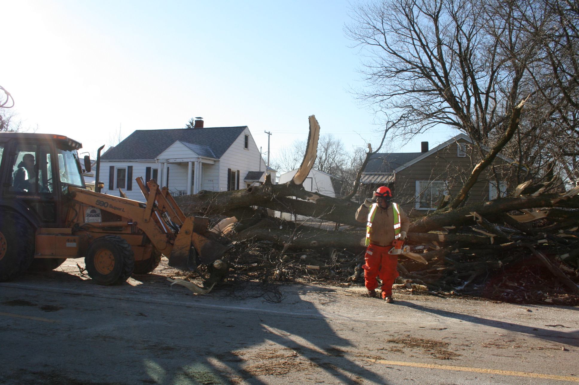 Crews Clean up large tree on S Chanute